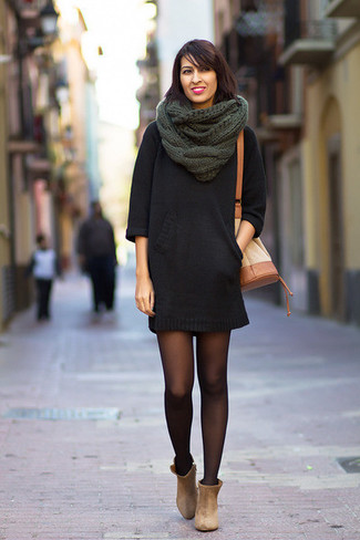 How to wear: black sweater dress, beige suede ankle boots, tan leather bucket bag, dark green knit scarf