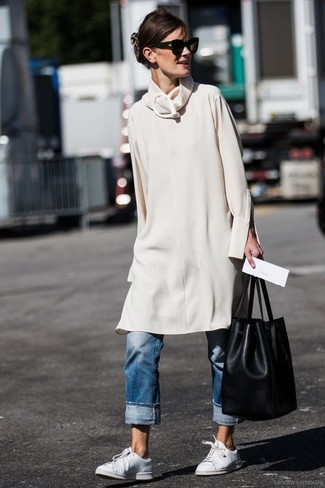 How to wear: beige sweater dress, blue boyfriend jeans, white leather low top sneakers, black leather bucket bag