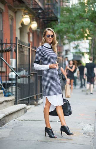 How to wear: white and black houndstooth sweater dress, white dress shirt, black cutout leather lace-up ankle boots, black leather tote bag