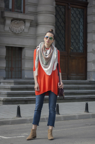 How to wear: orange sweater dress, blue jeans, tan suede ankle boots, dark purple leather crossbody bag
