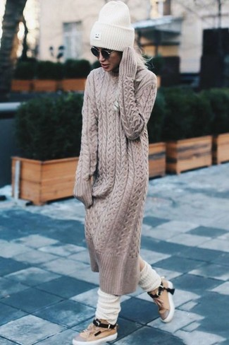 How to Wear a Beige Sweater Dress: Wear a beige sweater dress for a laid-back look with a modernized spin. Power up this look with tan leather low top sneakers.
