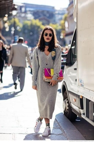 How to wear: grey sweater dress, white leather low top sneakers, multi colored leather satchel bag, teal print silk scarf
