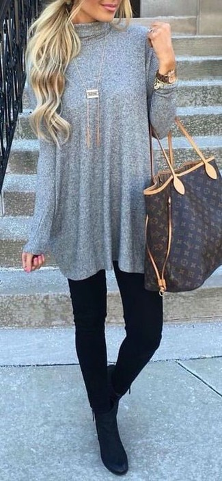 How to wear: grey sweater dress, black skinny jeans, black suede ankle boots, dark brown print leather tote bag