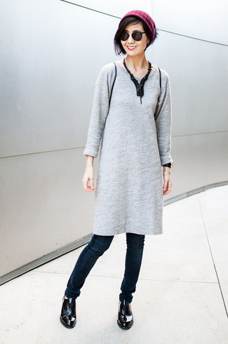 A grey sweater dress and navy skinny jeans will showcase your sartorial self. Add black leather loafers to your look for an instant style upgrade.