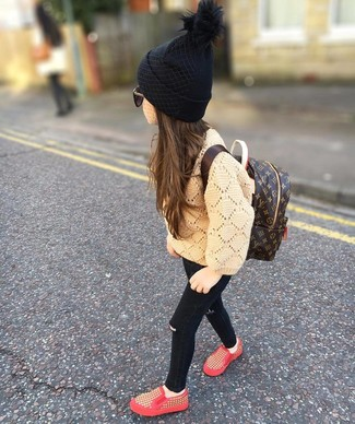 How to wear: tan sweater, black jeans, red sneakers, dark brown backpack