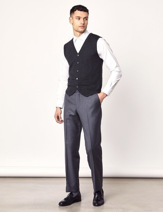 How to Wear Grey Wool Dress Pants For Men: This combo of a charcoal sweater vest and grey wool dress pants will add manly essence to your look. Dress down this outfit by sporting black leather tassel loafers.