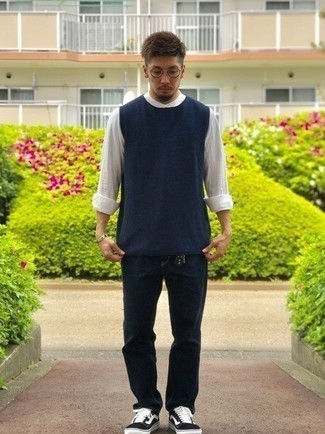 White Linen Long Sleeve Shirt Outfits For Men: Wear a white linen long sleeve shirt with navy jeans for a laid-back and cool and trendy outfit. Black and white canvas low top sneakers work amazingly well with this ensemble.