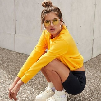 How to wear: yellow sweatshirt, black bike shorts, white leather high top sneakers, white socks