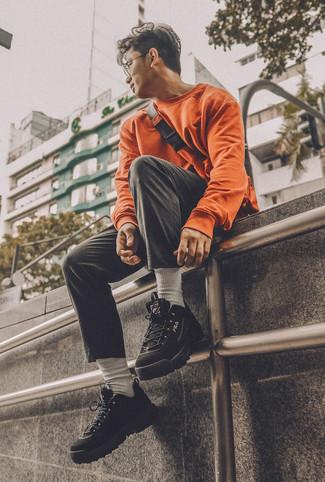 How to wear: orange sweatshirt, black chinos, black athletic shoes, orange fanny pack
