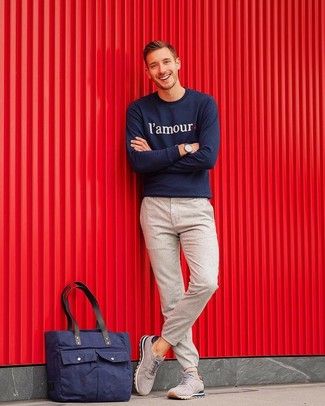 How to wear: navy print sweatshirt, beige wool chinos, grey suede athletic shoes, navy canvas tote bag