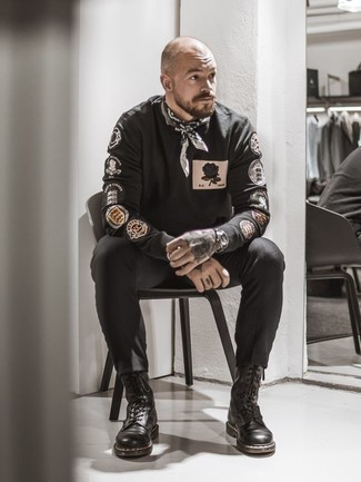 How to Wear a Black Print Sweatshirt For Men: Extremely dapper, this casual pairing of a black print sweatshirt and black chinos provides with excellent styling possibilities. And if you need to easily dress up this look with shoes, complete this getup with black leather casual boots.
