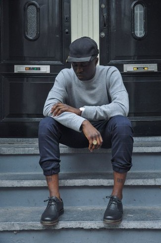 Grey Sweatshirt Outfits For Men: If you need to go about your day with confidence in your ensemble, pair a grey sweatshirt with navy check chinos. If you feel like dialing it up, introduce black leather derby shoes to the equation.