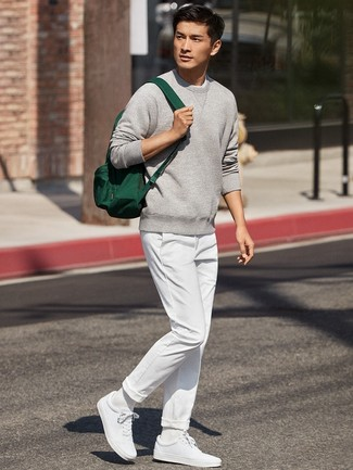 How to wear: grey sweatshirt, white chinos, white low top sneakers, dark green canvas backpack