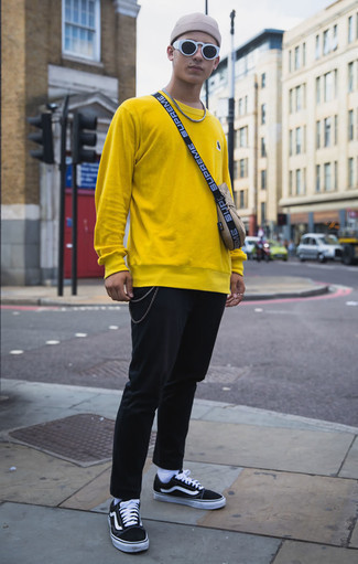 How to Wear Socks For Men: To put together an off-duty getup with a twist, reach for a yellow sweatshirt and socks. Black and white canvas low top sneakers are an effective way to upgrade your look.