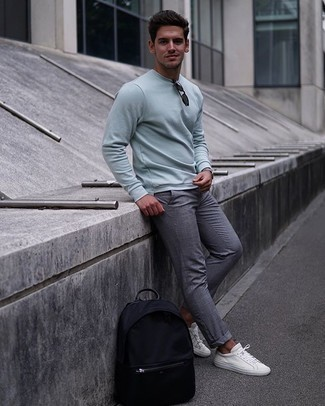 Men's Outfits 2020: You'll be surprised at how super easy it is for any gentleman to get dressed this way. Just a light blue sweatshirt and grey plaid chinos. If you're not sure how to finish, introduce white canvas low top sneakers to the mix.