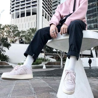 White and Red Leather Low Top Sneakers Outfits For Men: For a casual outfit, make a pink sweatshirt and black chinos your outfit choice — these two items play nicely together. If you're on the fence about how to finish off, a pair of white and red leather low top sneakers is a wonderful option.