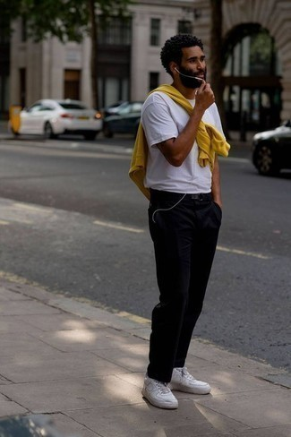 How to Wear Black Corduroy Chinos: This casual combination of a yellow sweatshirt and black corduroy chinos is super easy to throw together without a second thought, helping you look amazing and ready for anything without spending too much time digging through your wardrobe. White leather low top sneakers look wonderful here.