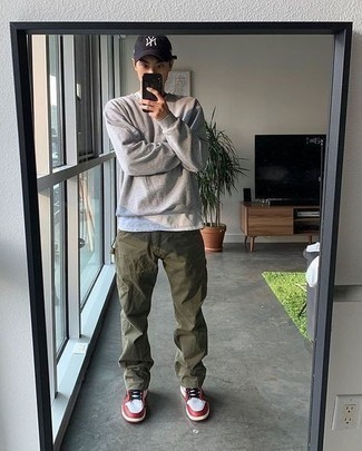 White and Red Leather Low Top Sneakers Outfits For Men: For comfort dressing with a fashionable spin, you can easily dress in a grey sweatshirt and olive chinos. As for footwear, complete this look with white and red leather low top sneakers.