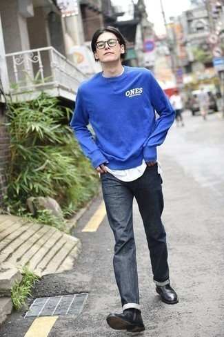 How To Wear Blue Jeans With Black Leather Boots For Men: This combo of a blue print sweatshirt and blue jeans is on the off-duty side but is also on-trend and seriously stylish. Finishing off with black leather boots is the most effective way to introduce a bit of depth to this look.