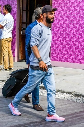 How to Wear a Navy Baseball Cap For Men: Nail the casual and cool look in a light blue print sweatshirt and a navy baseball cap. Complement this ensemble with red and white athletic shoes to change things up a bit.