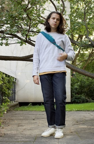 Socks Outfits For Men: Breathe an off-duty touch into your current lineup with a grey sweatshirt and socks. White leather low top sneakers are the most effective way to transform your getup.