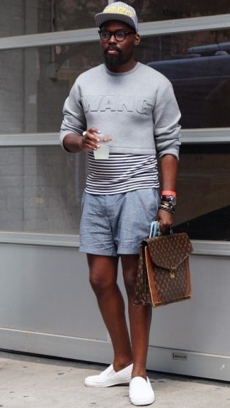 White Canvas Slip-on Sneakers Outfits For Men: This combination of a grey sweatshirt and light blue shorts looks awesome and immediately makes any gent look cool. White canvas slip-on sneakers serve as the glue that will pull your ensemble together.