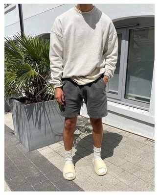 Sandals Outfits For Men: We're all on a mission for comfort when it comes to styling, and this contemporary combo of a grey sweatshirt and charcoal sports shorts is an amazing example of that. On the shoe front, go for something on the casual end of the spectrum and finish this outfit with sandals.