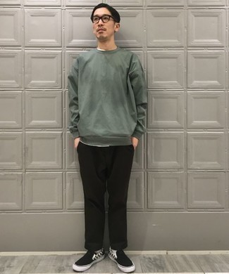 Dark Green Sweatshirt Outfits For Men: Consider teaming a dark green sweatshirt with black chinos to don a casual and cool getup. Let your outfit coordination skills really shine by finishing this outfit with a pair of black and white check canvas slip-on sneakers.