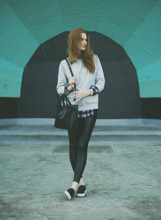 Wear a grey sweatshirt and black leather leggings for a comfy-casual look. This outfit is complemented perfectly with black leather slip-on sneakers.