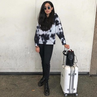 How to wear: black and white tie-dye sweatshirt, black jeans, black leather lace-up flat boots, black leather bucket bag