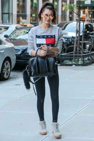 How to wear: grey print sweatshirt, black leggings, grey suede high top sneakers, black leather satchel bag