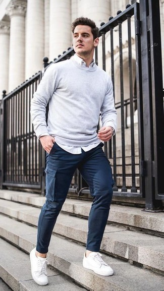 How to Wear a Grey Sweatshirt Casually For Men: This pairing of a grey sweatshirt and navy cargo pants is hard proof that a safe casual look doesn't have to be boring. White leather low top sneakers integrate wonderfully within a variety of combos.