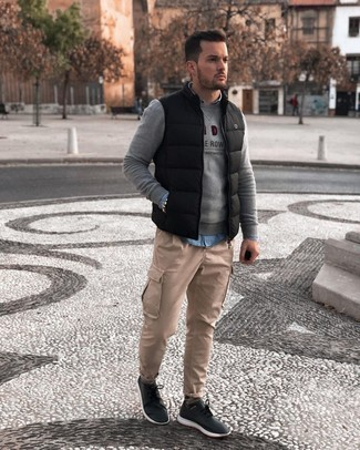 Khaki Cargo Pants Outfits: If you're seeking to take your casual fashion game to a new height, dress in a grey embroidered sweatshirt and khaki cargo pants. Switch up your getup with more relaxed footwear, such as these black and white athletic shoes.