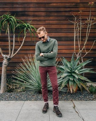 Dark Green Sweatshirt Outfits For Men: A dark green sweatshirt and burgundy jeans are a combination that every sharp gentleman should have in his casual arsenal. Why not take a more refined approach with footwear and complete this outfit with dark brown suede casual boots?