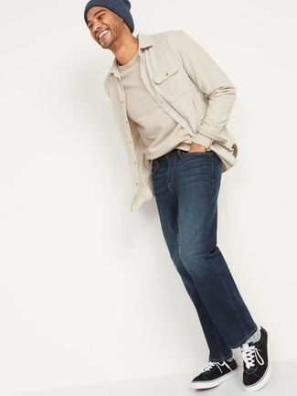 Beige Long Sleeve Shirt Outfits For Men: Marrying a beige long sleeve shirt with navy jeans is a wonderful option for a casual yet seriously stylish ensemble. A pair of black and white canvas low top sneakers makes your look whole.