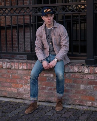 Men's Outfits 2021: We all seek functionality when it comes to styling, and this city casual pairing of a grey print sweatshirt and blue ripped jeans is a great illustration of that. Puzzled as to how to finish off this outfit? Wear a pair of brown suede desert boots to ramp it up a notch.