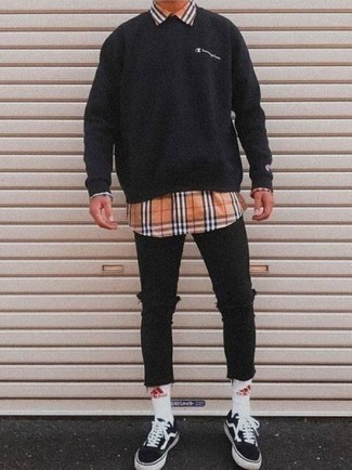 Men's Looks & Outfits: What To Wear In a Relaxed Way: One of the most popular ways for a man to style out a black sweatshirt is to pair it with black ripped skinny jeans for an off-duty getup. For extra style points, complement your outfit with a pair of black and white canvas low top sneakers.