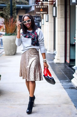 How to wear: grey print sweatshirt, gold sequin midi skirt, black leather heeled sandals, black leather crossbody bag