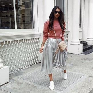 How to wear: red sweatshirt, silver pleated midi skirt, white leather low top sneakers, beige leather crossbody bag