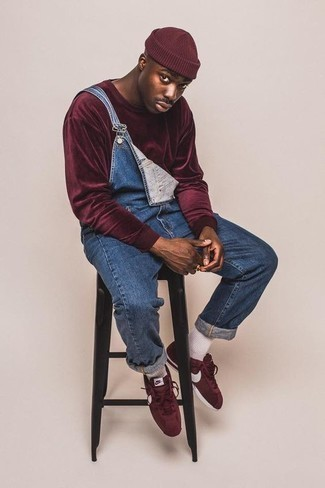 Blue Denim Overalls Outfits For Men: Indisputable proof that a burgundy sweatshirt and blue denim overalls are awesome when worn together in an off-duty outfit. Burgundy canvas low top sneakers look wonderful finishing off this look.
