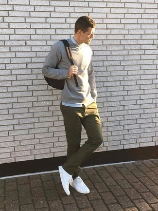 How to Wear a Sweater For Men: A sweater and olive chinos are a combo that every trendsetting gent should have in his casual styling arsenal. If you want to easily class up your outfit with a pair of shoes, why not throw a pair of white canvas low top sneakers in the mix?