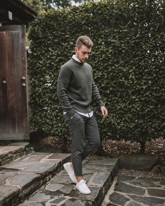 Dark Green Sweater with White Shirt Outfits For Men: This combination of a dark green sweater and a white shirt looks amazing and instantly makes you look cool. Put a different spin on an otherwise everyday ensemble by rounding off with a pair of white canvas low top sneakers.