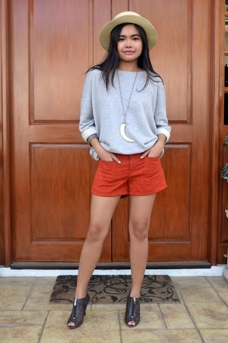 How to wear: grey sweatshirt, orange shorts, dark brown cutout leather ankle boots, khaki straw hat