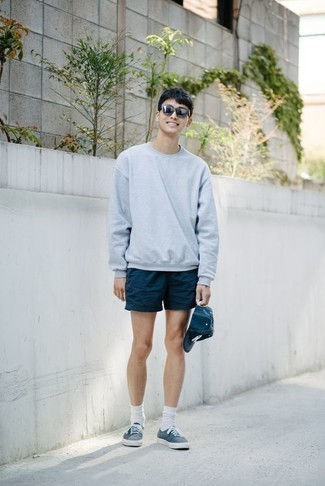 How to Wear White Socks For Men: A light blue sweatshirt and white socks are stylish menswear items, without which no casual wardrobe would be complete. Serve a little mix-and-match magic by rounding off with navy canvas low top sneakers.