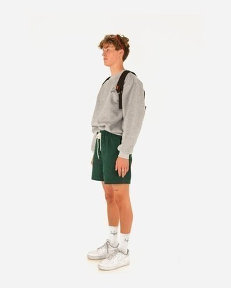 Grey Sweatshirt Outfits For Men In Their Teens: A grey sweatshirt and dark green shorts are a pairing that every dapper gentleman should have in his casual styling routine. Complete this ensemble with white canvas low top sneakers and you're all set looking dashing. Those who wonder how to dress stylishly as you work your way through your teen years, you have your answer.