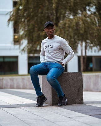 Blue Skinny Jeans Outfits For Men: To pull together a casual look with an urban twist, you can easily dress in a grey print sweatshirt and blue skinny jeans. In the shoe department, go for something on the relaxed end of the spectrum and round off your ensemble with a pair of black athletic shoes.