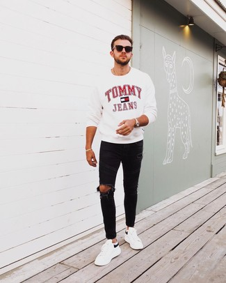 How to wear: white print sweatshirt, black ripped skinny jeans, white and black leather low top sneakers, black sunglasses