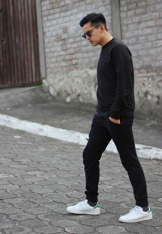 How to wear: black sweatshirt, black sweatpants, white leather low top sneakers, black sunglasses