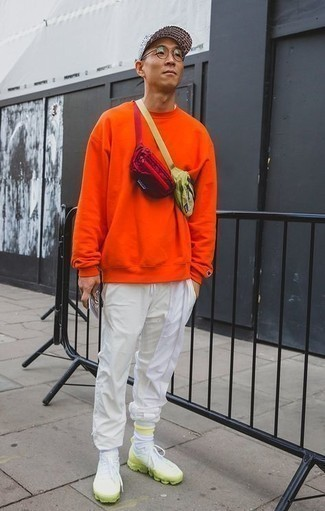 Socks Outfits For Men: An orange sweatshirt and socks are essential in any modern gentleman's functional casual closet. White and green athletic shoes are a stylish companion to this outfit.