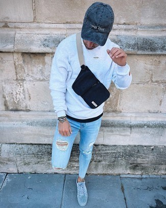 Bag Outfits For Men: This combo of a grey sweatshirt and a bag is a safe bet for an effortlessly dapper getup. If you want to immediately perk up this look with one item, why not complete your look with light blue suede low top sneakers?